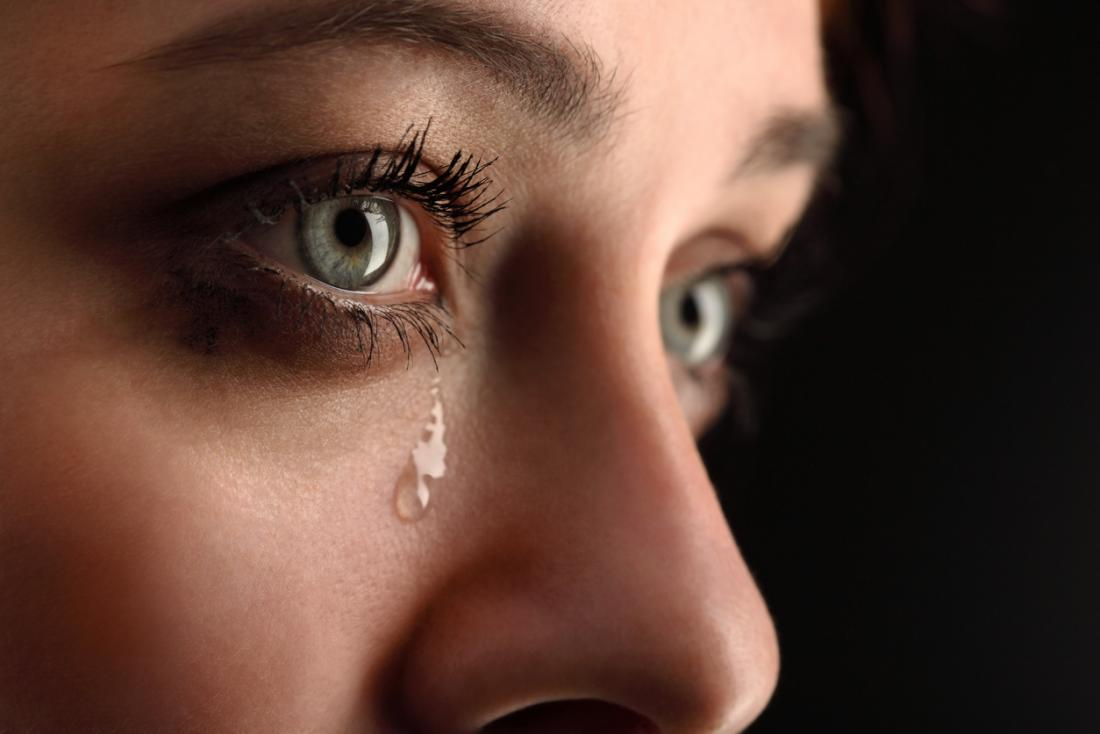 Crying woman with tear drop.