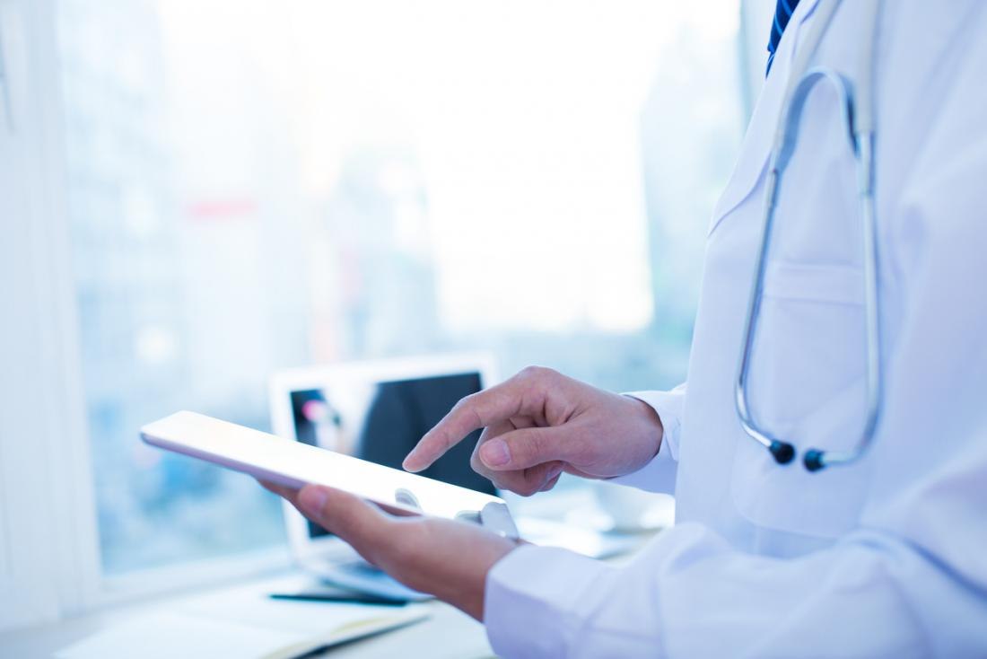 doctor checking notes on a tablet