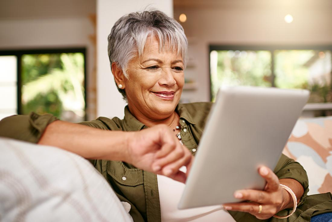 older woman looking at tablet