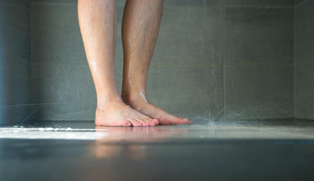man standing in the shower