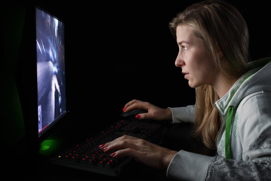 girl playing action video game