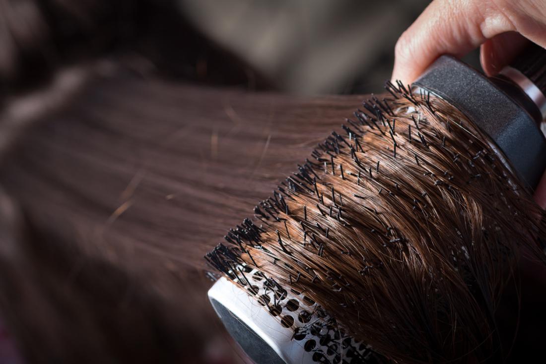 Hair being brushed.