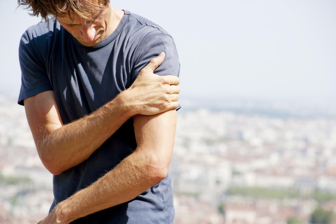 Man with pain in his arm and shoulder.