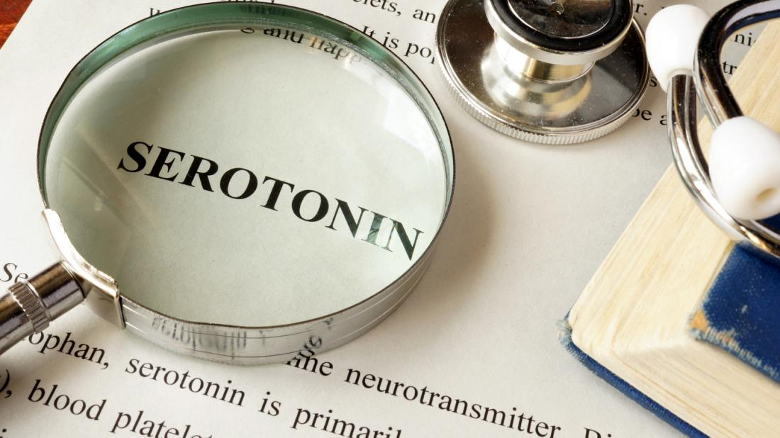 serotonin word with magnifying glass on it