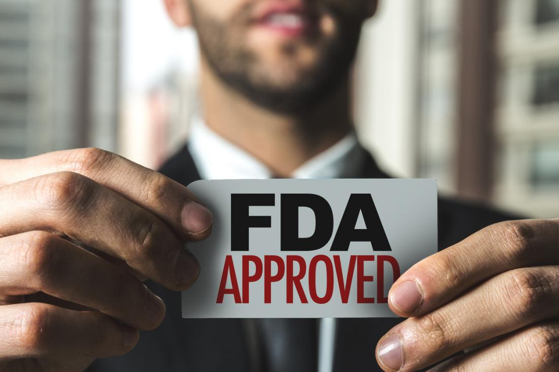 man holding FDA approved stamp