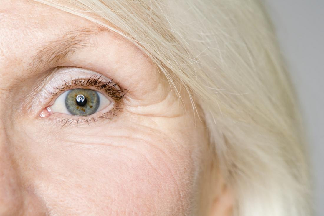 a close up of the eye of an older woman