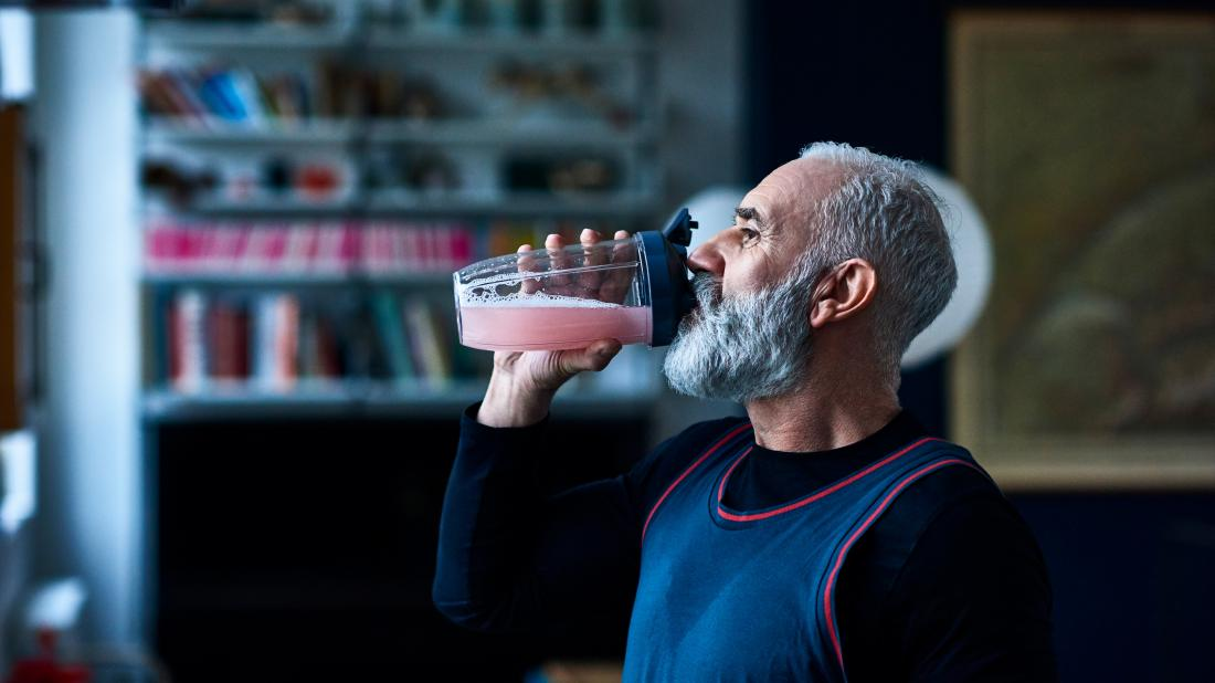 a man drinking a protein shake as it is part of his diet