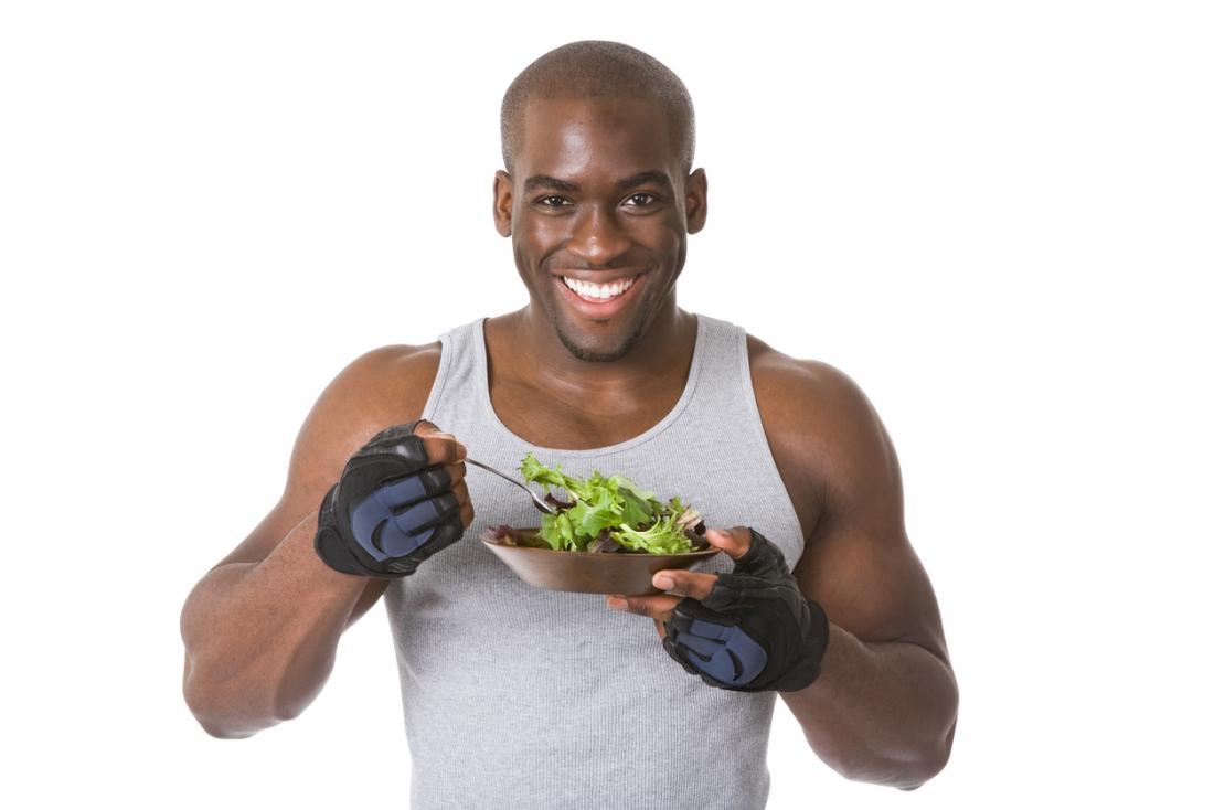 a man eating a salad after a workout
