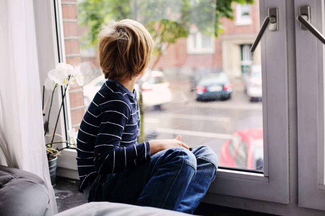 Boy looking out of window.