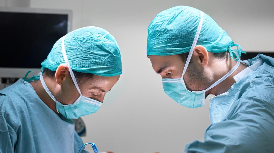 two surgeons performing a hemicolectomy