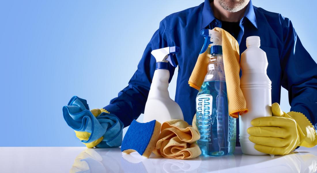 man with house cleaning products