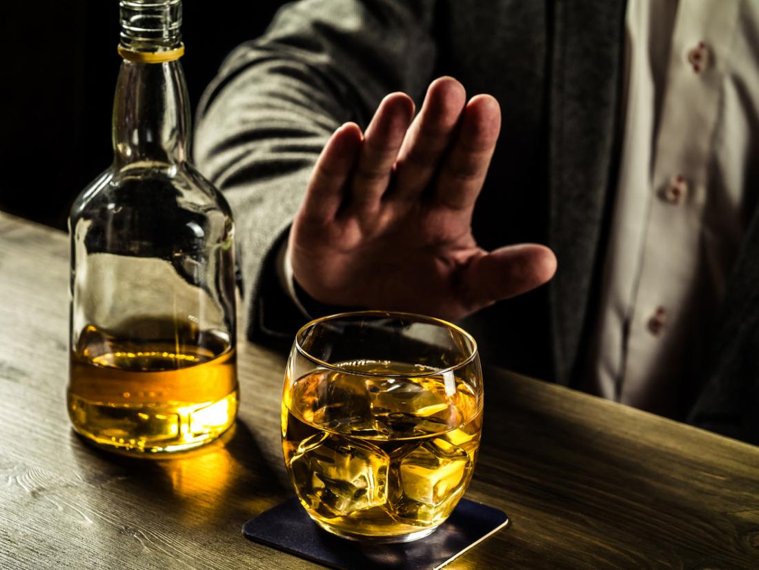 man turning down whisky