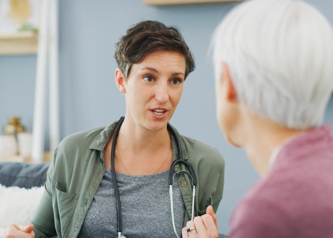 woman discusses diagnosis with doctor