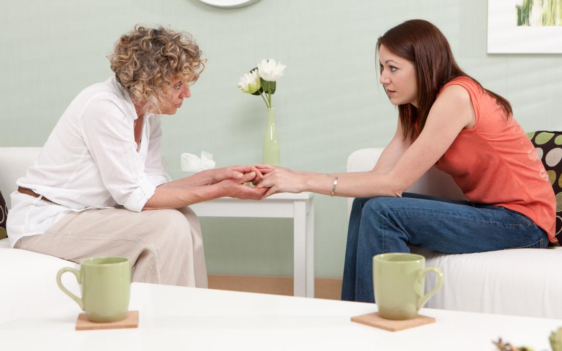 therapist holding hands with patient