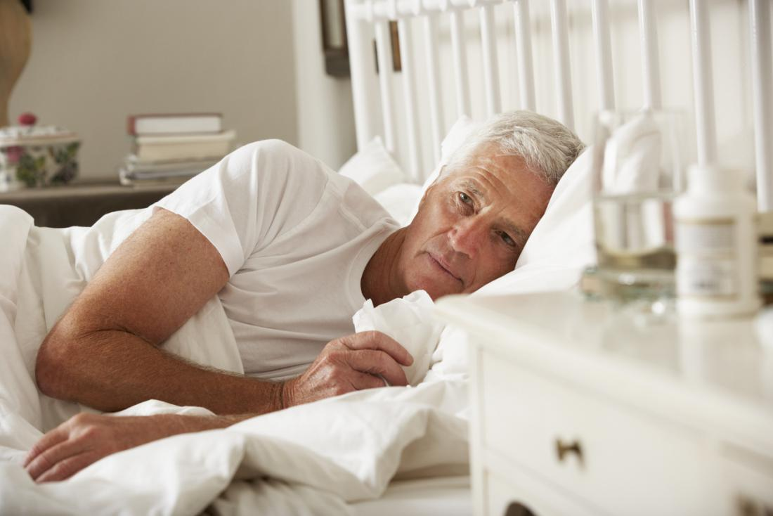 senior man in bed with the flu