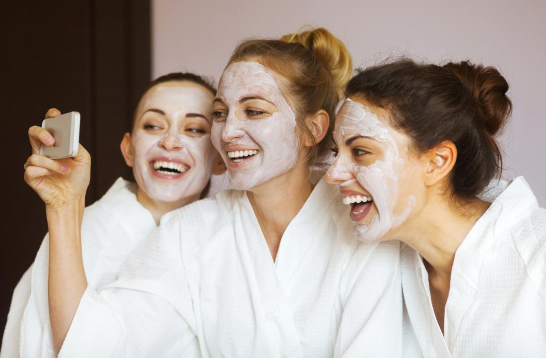 three women with wearing beauty face masks