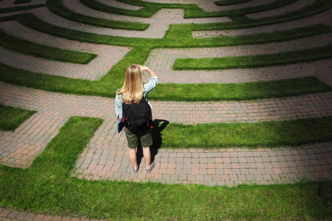 woman navigating her way out of a maze