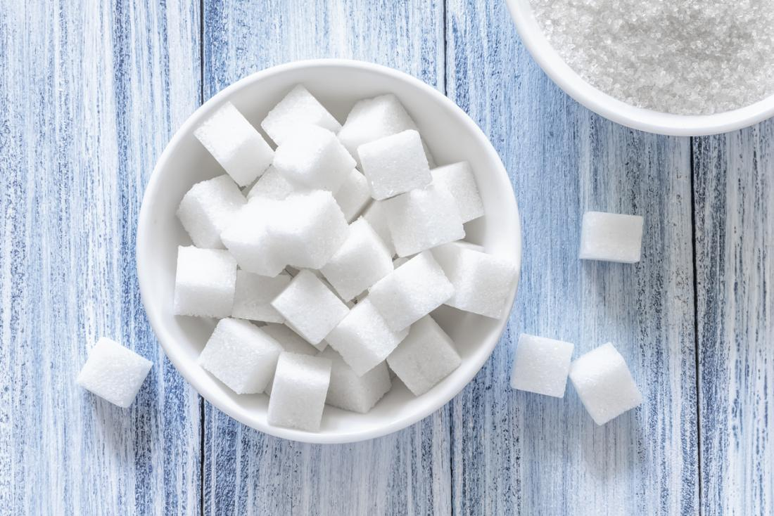 a bowl of white sugar cubes