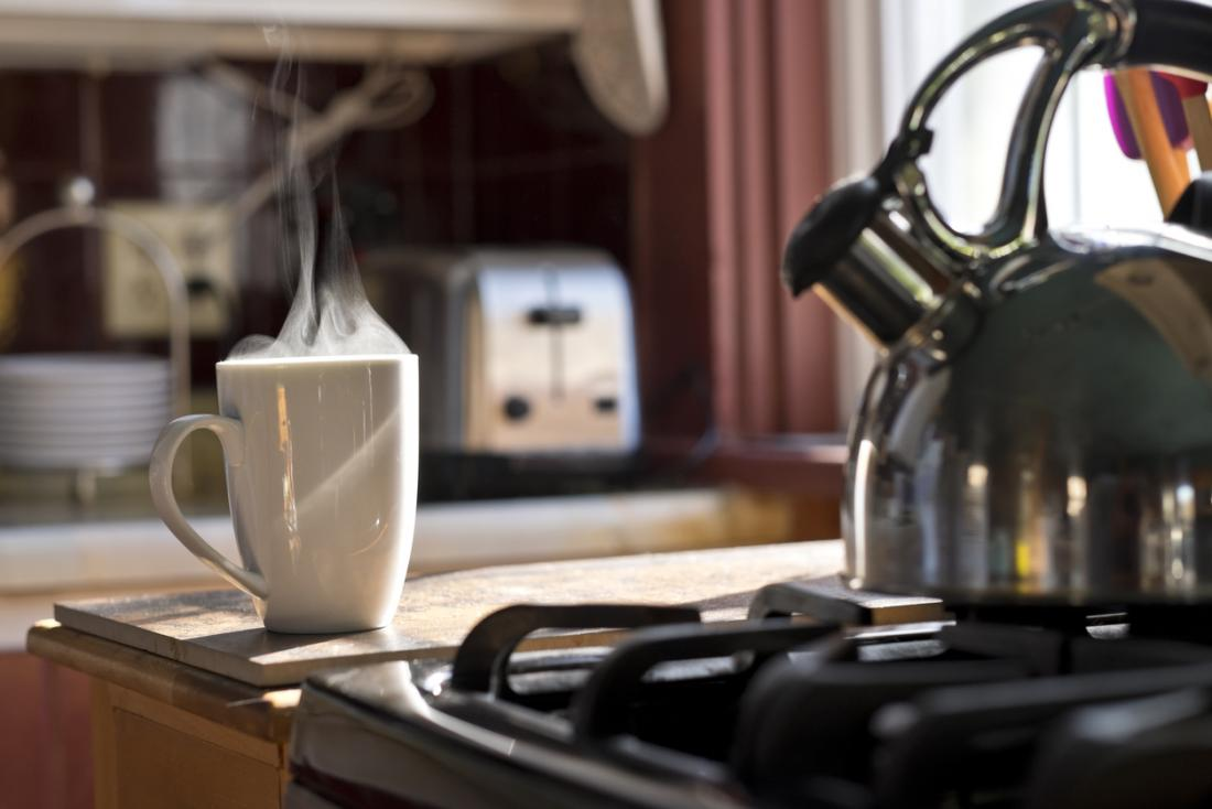 hot drink next to stove top kettle