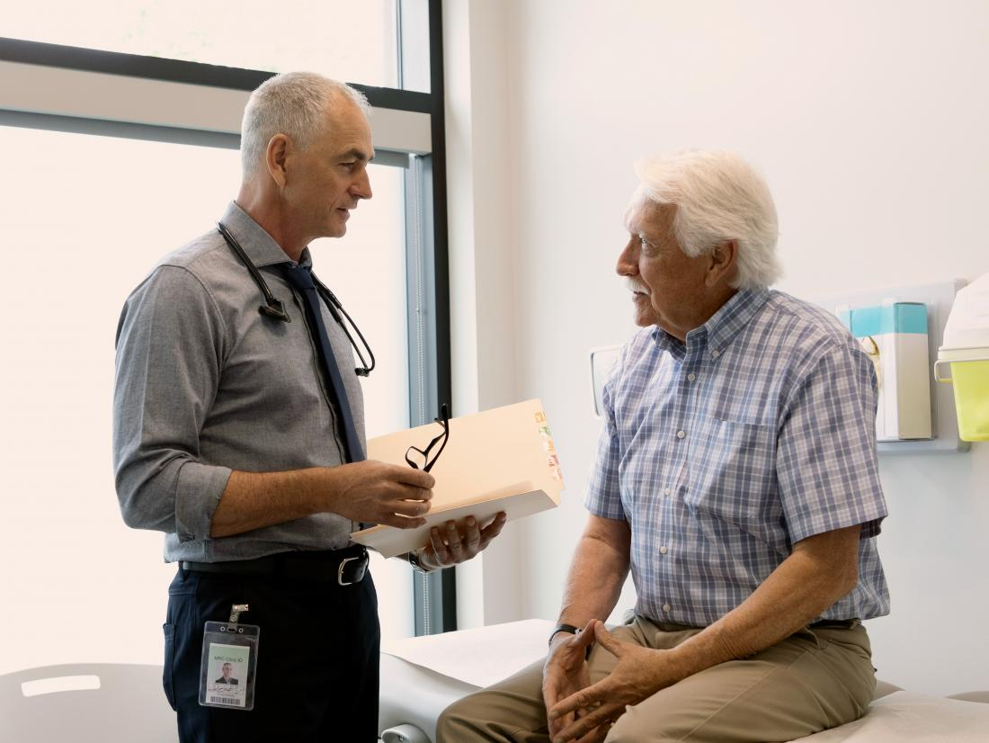 a doctor discussing the possibility of a prostate nodules with a male patient.