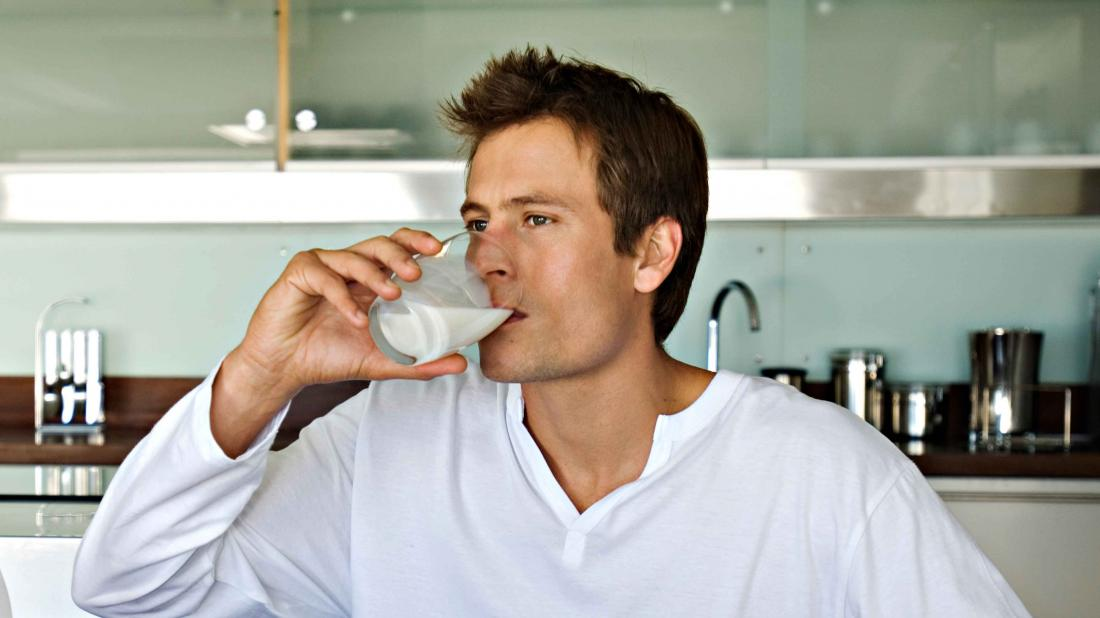 a man drinking milk as part of his diet a few days after a gastric sleeve procedure