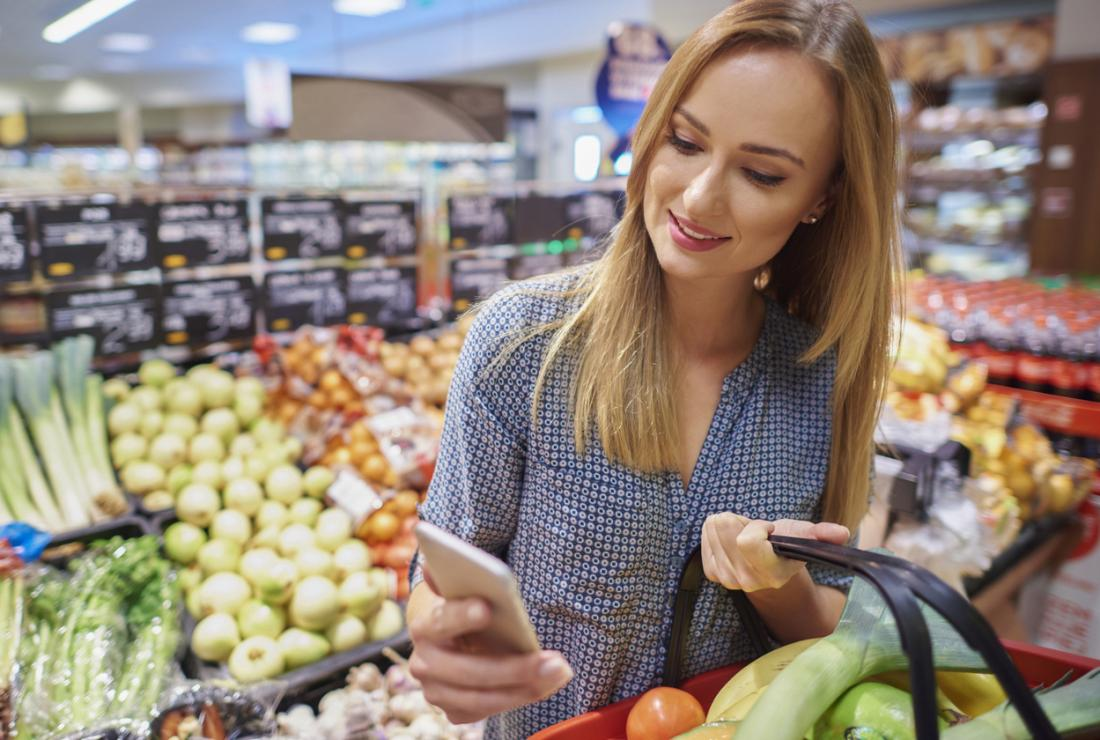 woman checking nutritional content of food on her phone