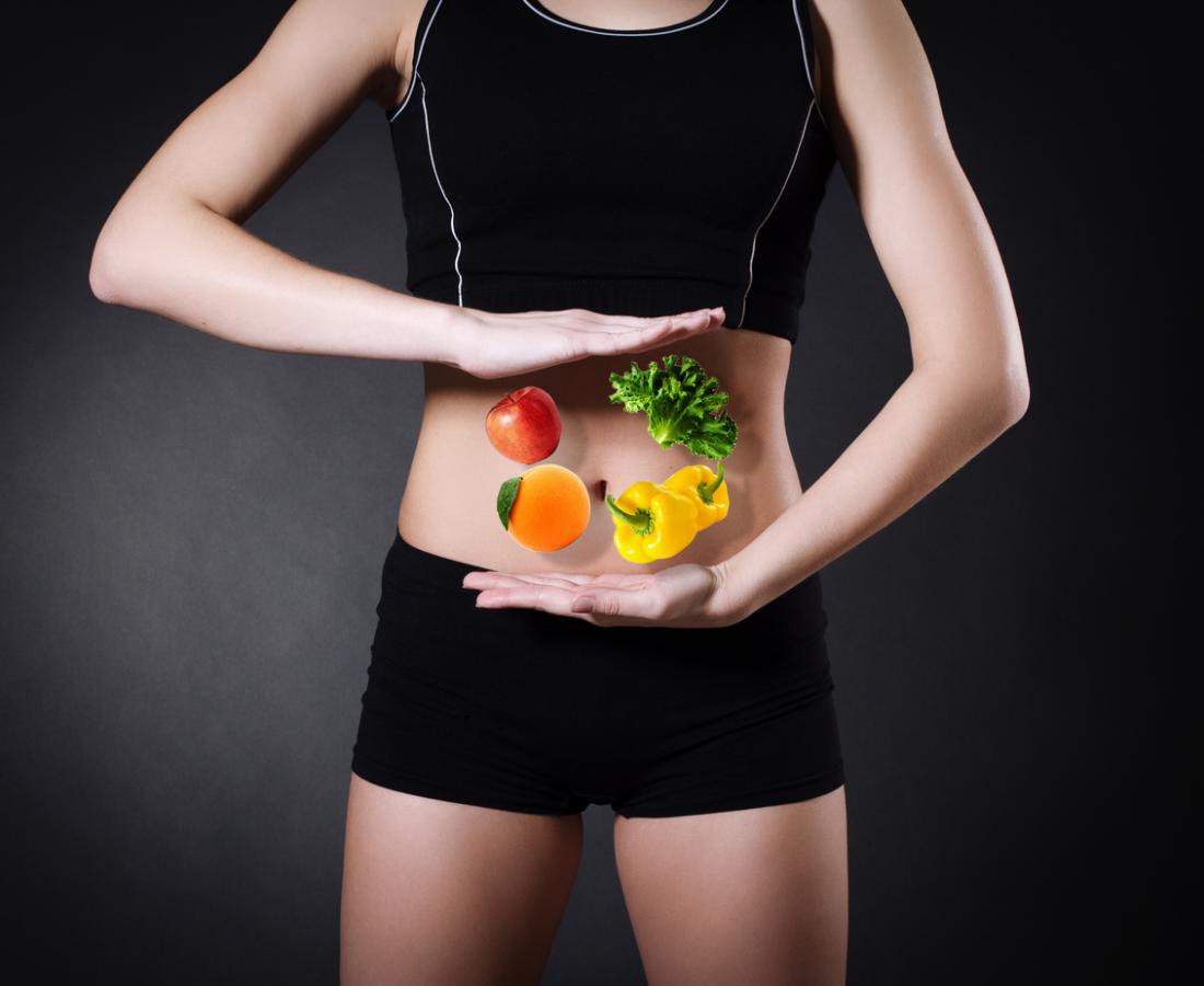 woman with illustration of food in front of her belly