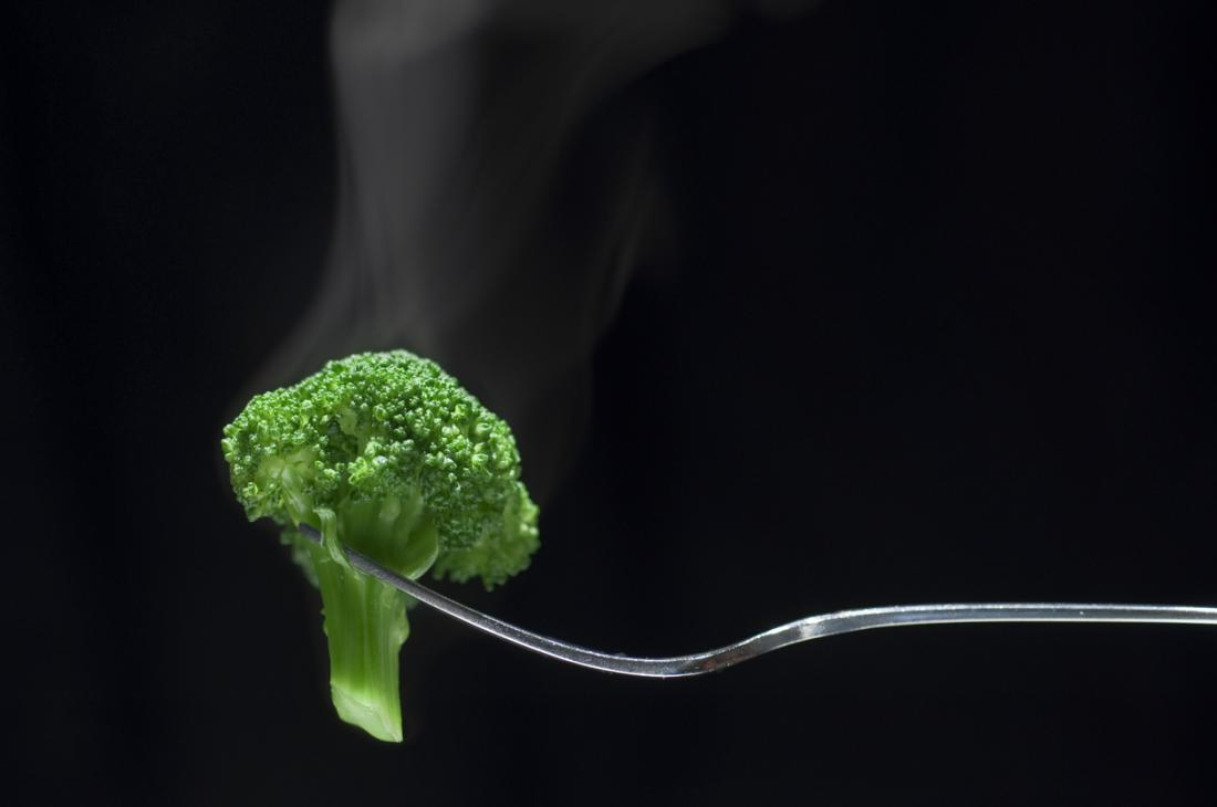 Steaming broccoli on a fork