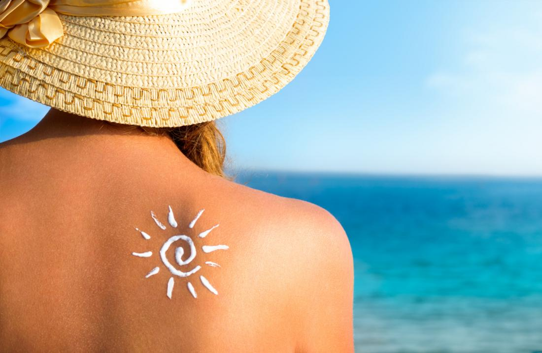 woman in the sun wearing sunhat and sunscreen