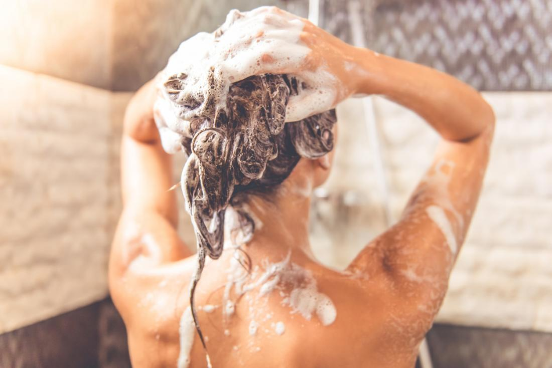 Lady in a shower washing her hair