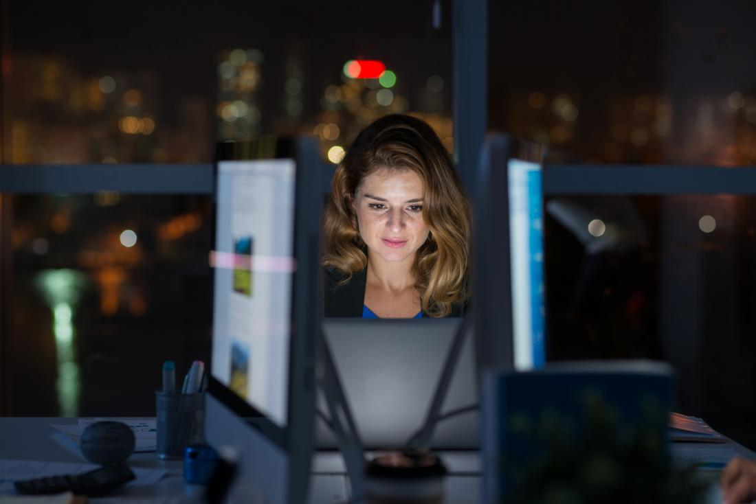 woman working at her computer at night