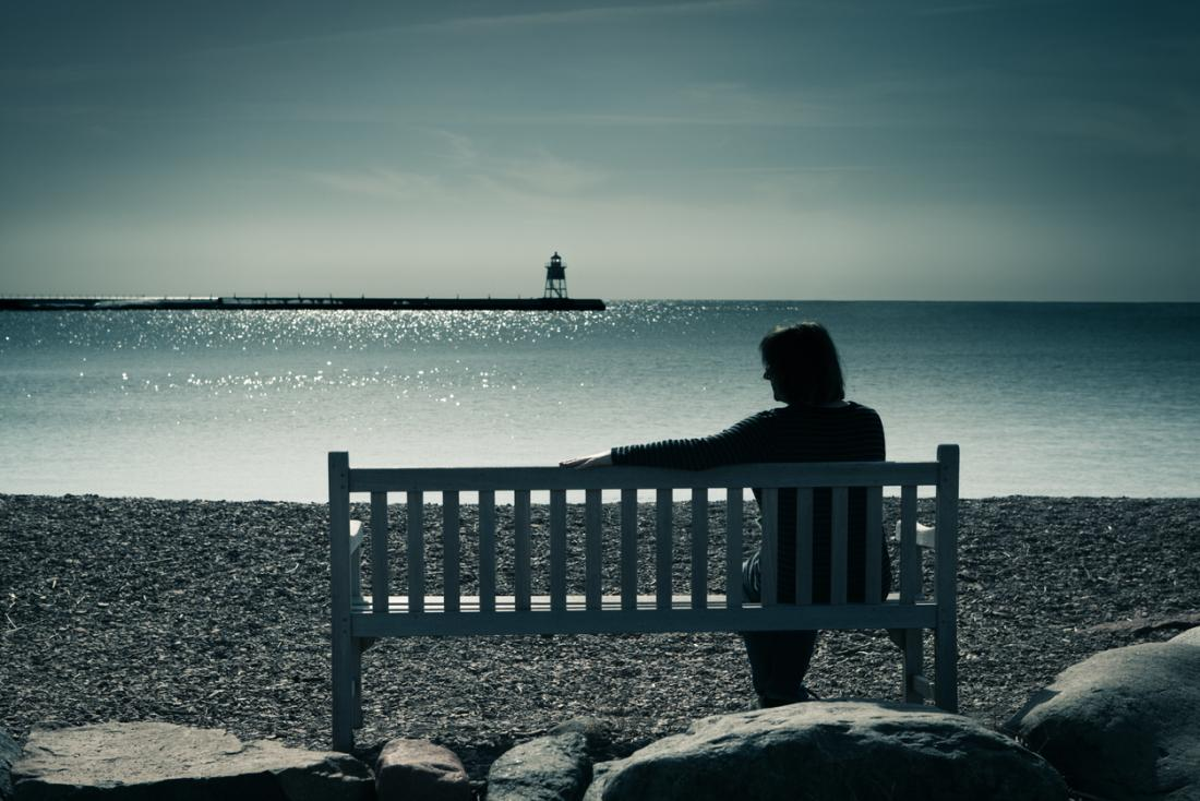 lonely person on a bench