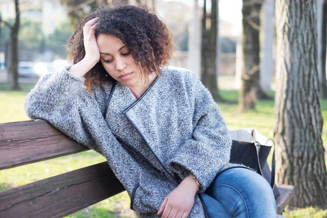 a stressed woman on a bench