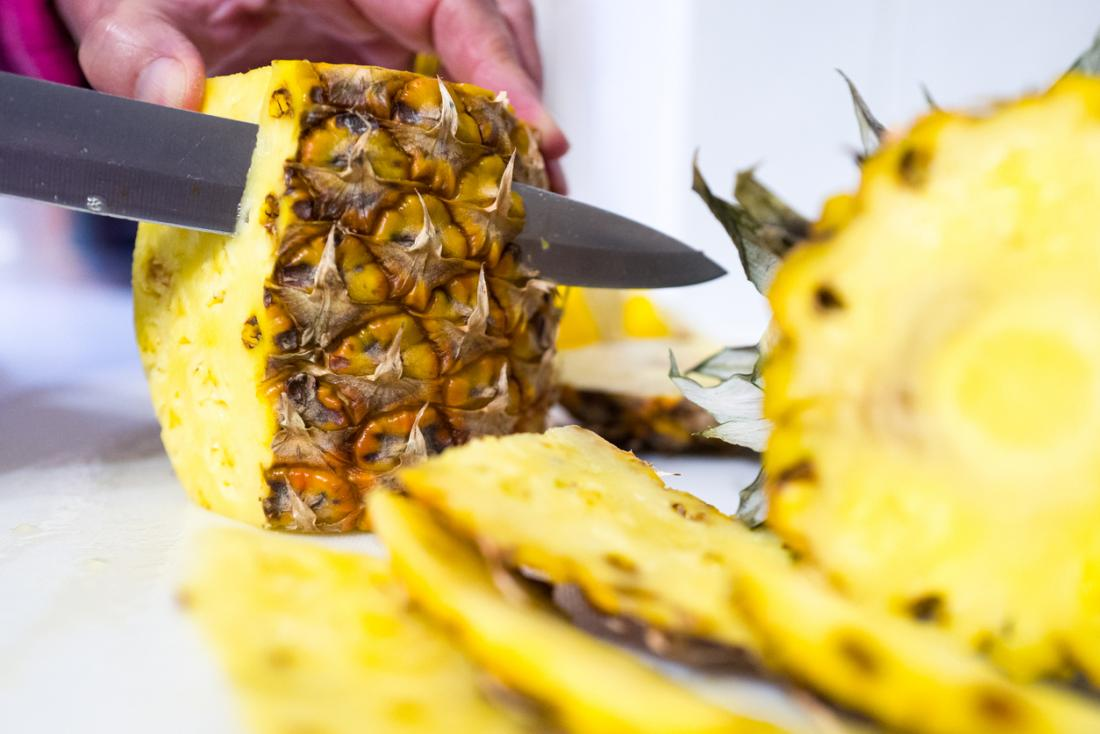 Pineapple being cut up.