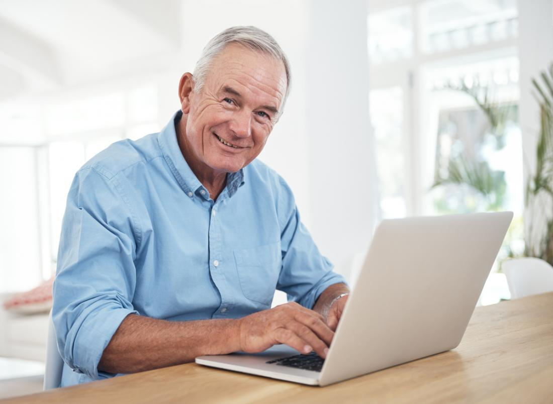 an older man using a laptop