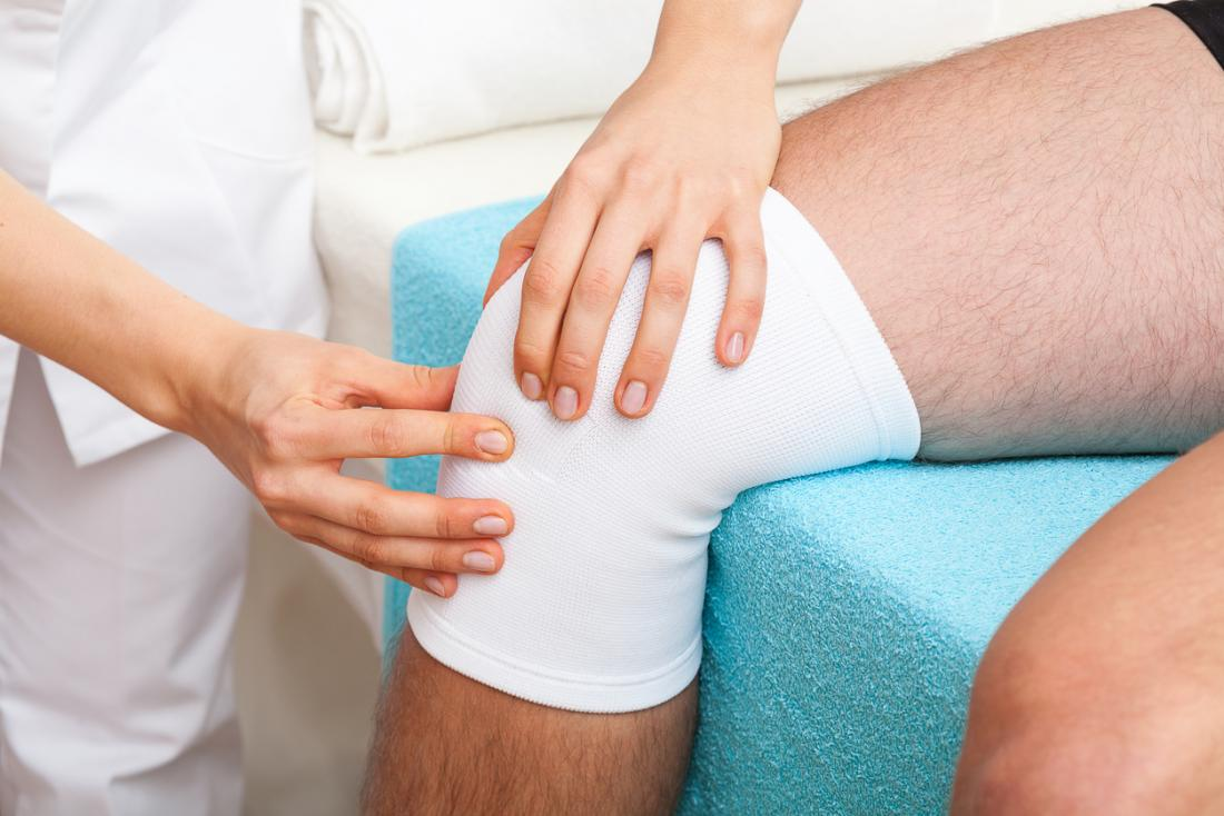 Person with knee injury having physical therapy