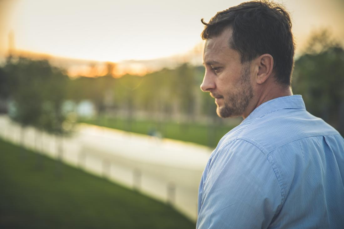 a man looking pensive about his bone marrow cancer diagnosis