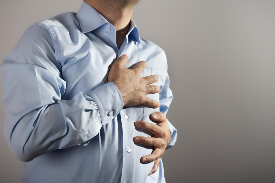 Man with multiple sclerosis hugging his chest in pain.