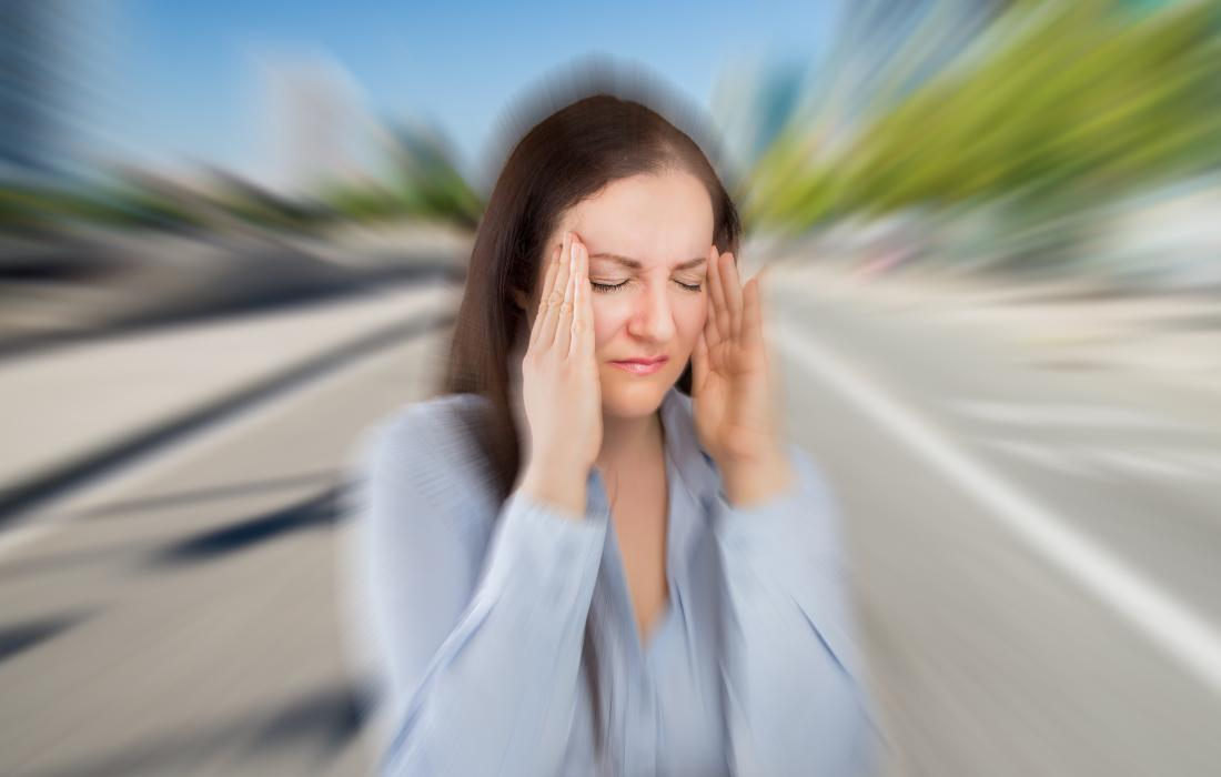 a woman experiencing a migraine