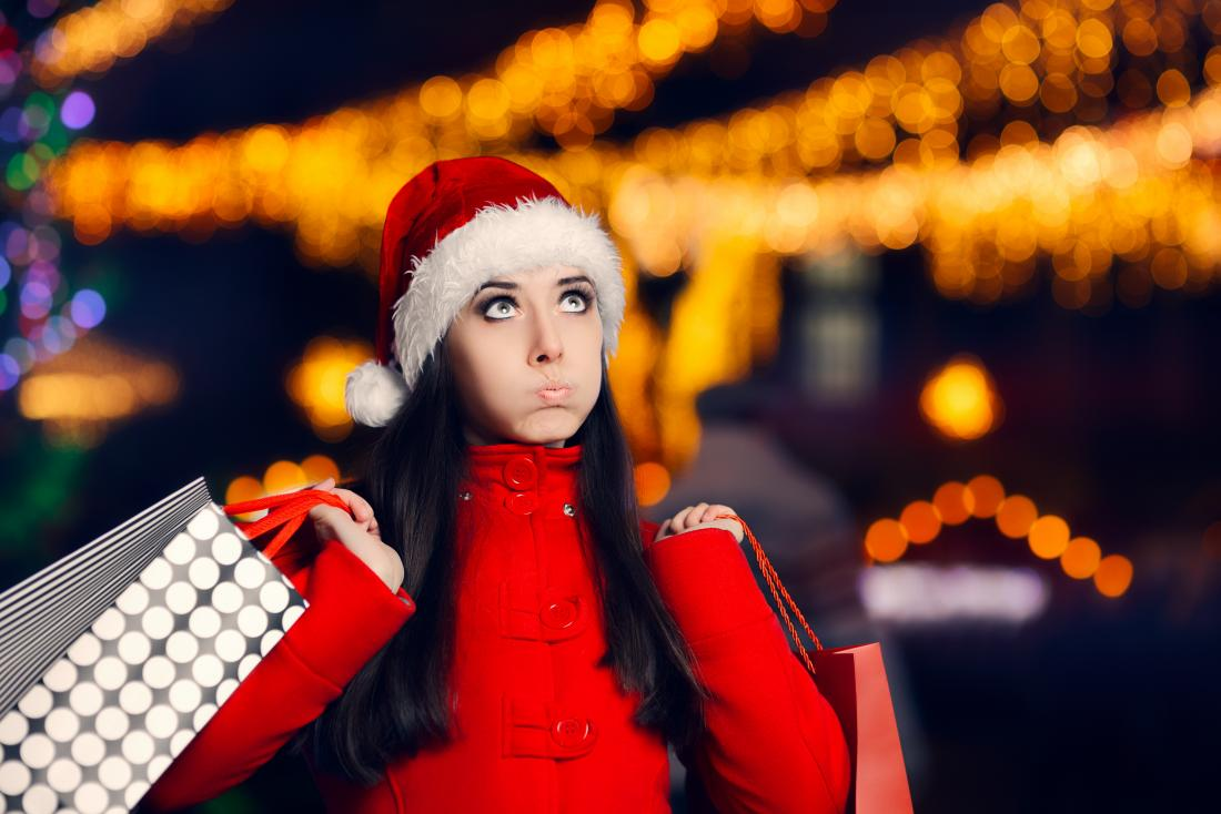 woman wearing Christmas hat and shopping