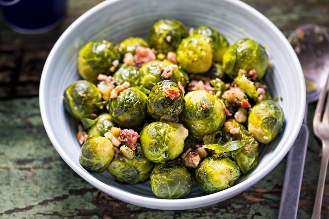 a bowl of brussels sprouts with bacon