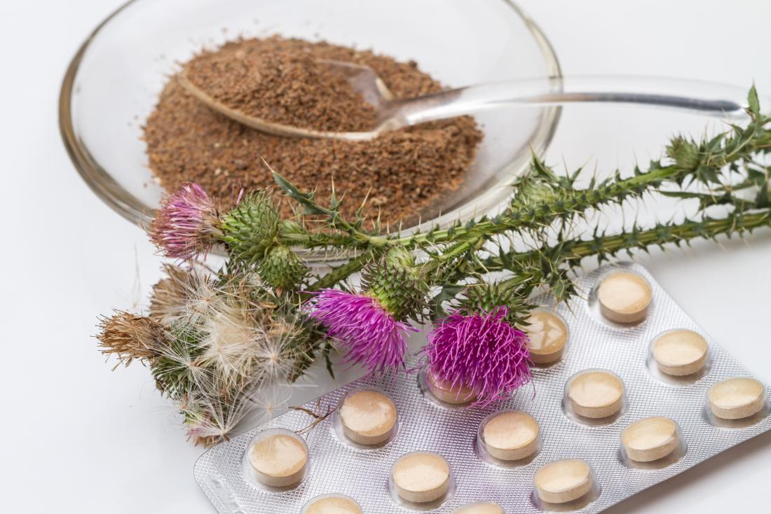 Milk thistle plants with powdered extract and supplements.