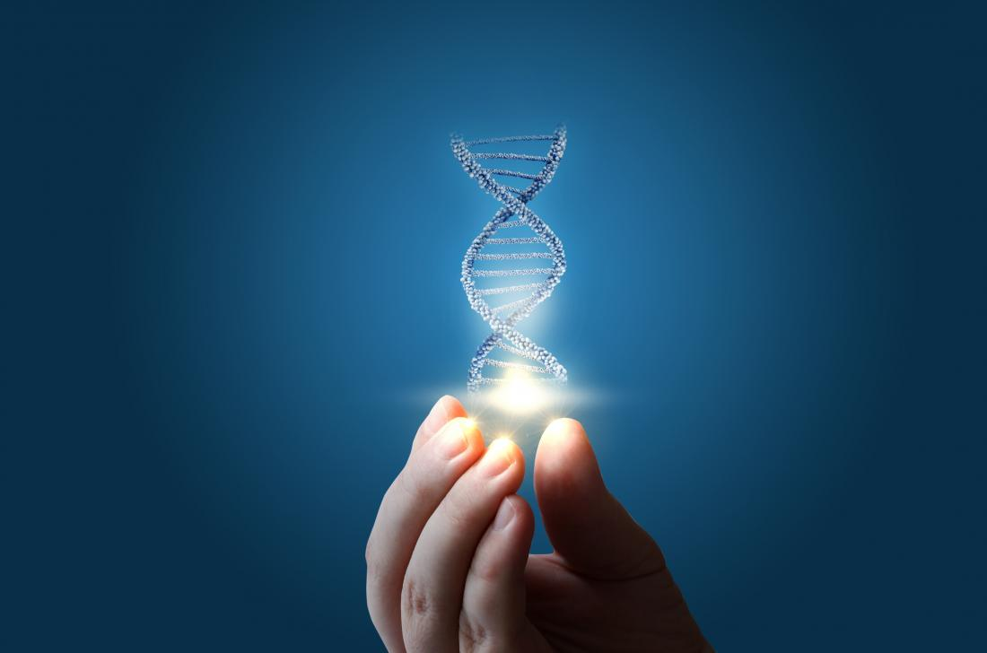 a woman holding a strand of DNA