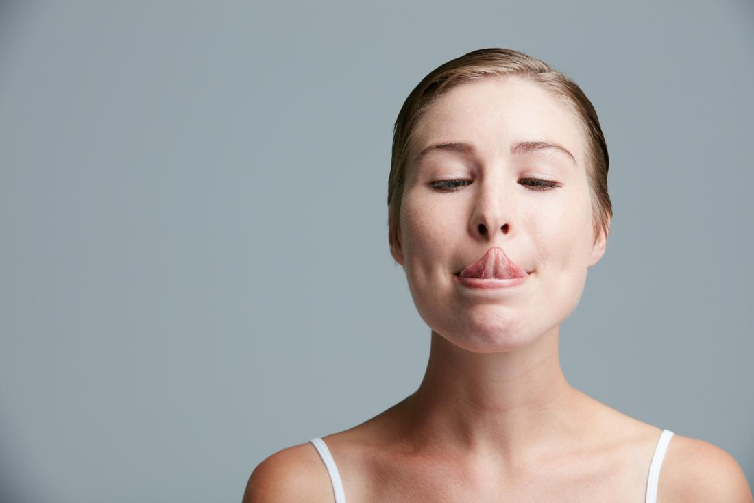 young woman sticking her tongue out