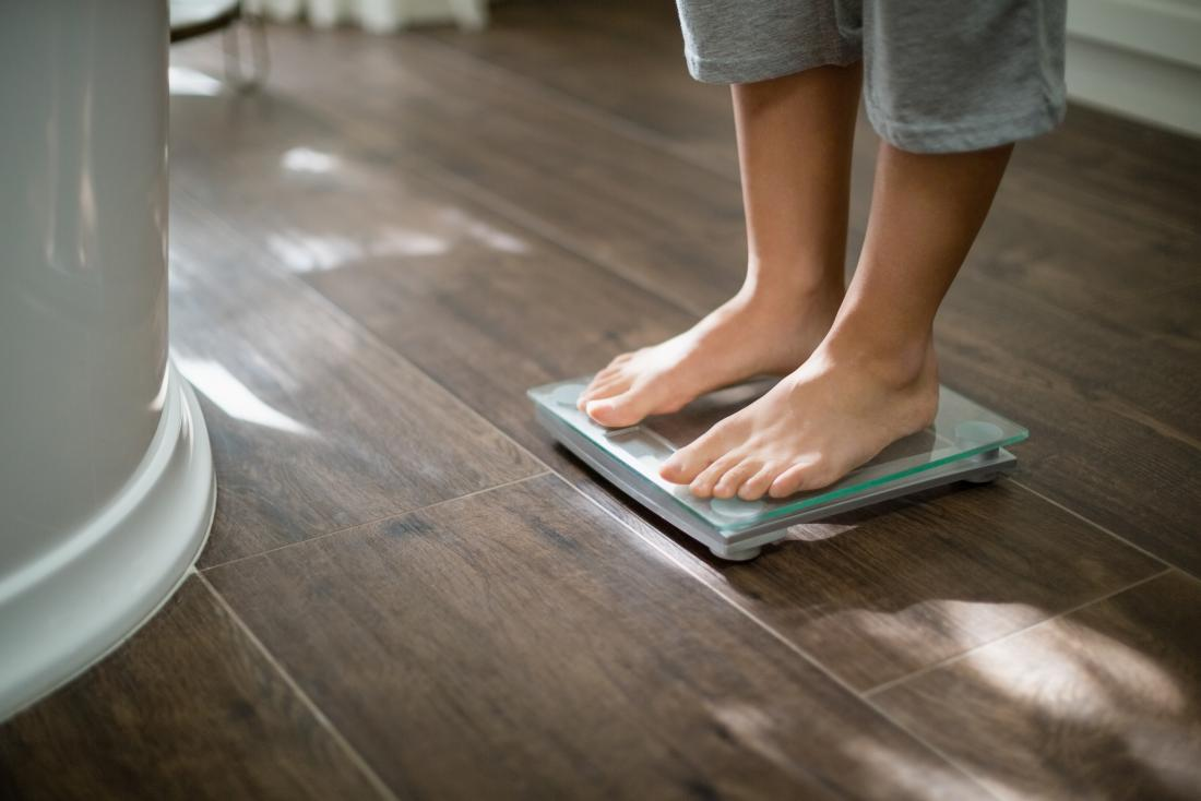 boy weighing on scales