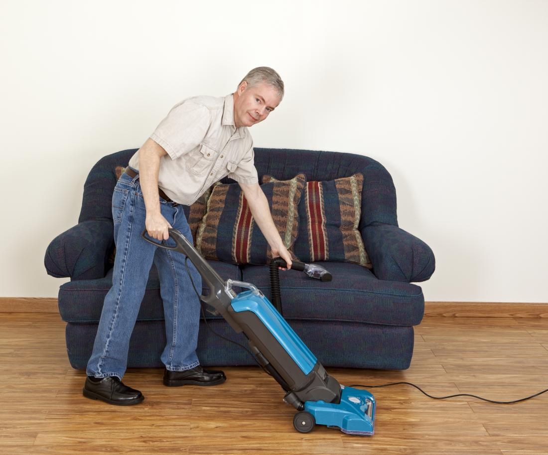 an older man hoovering