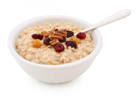 bowl of oatmeal with nuts and fruit