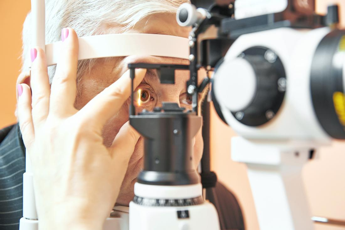 person having eye exam