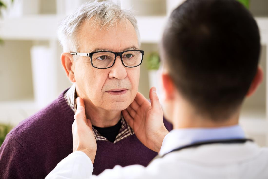 Doctor holding swollen lymph nodes adenopathy diagnosis