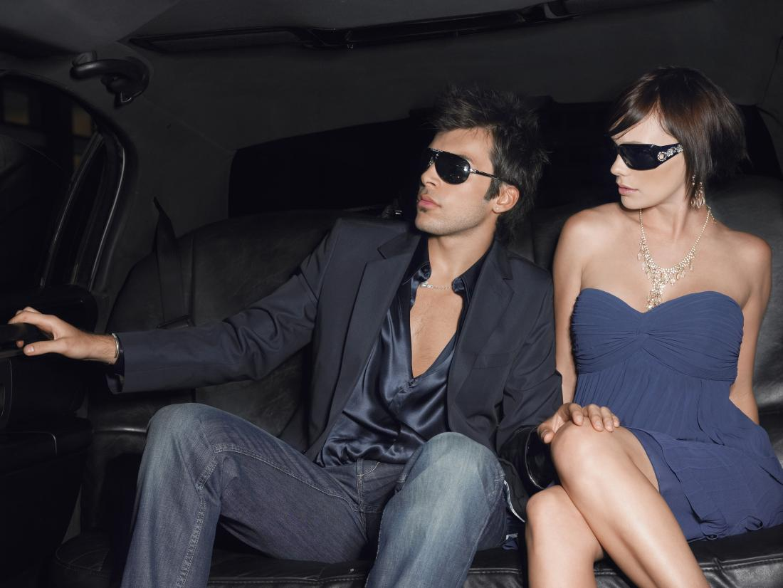 rich couple in limo